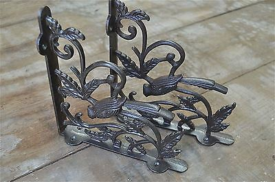 A pair of antique Victorian exotic bird brackets cast iron shelf bracket AL23 3