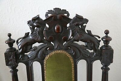 Pair of Antique oak throne armchairs with carved lions and intricate detail 4