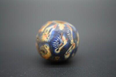 Medieval Islamic glass face bead C. 13th century AD 2