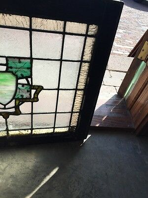 Sg 562 Antique Stainglass Window Depicting A Crest And Painted Leaves