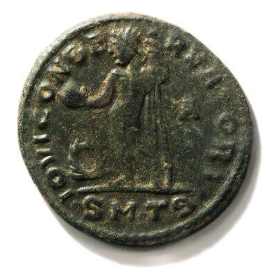 Bronze Coin of Roman Emperor Maximinaus II (309-313 AD). Follis in Very Fine con