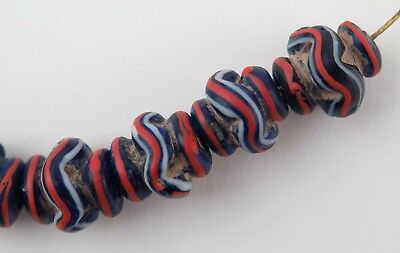 Fifteen blue red & white striped glass collared vase trade beads. 6