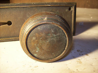 3 avail. Bronze beveled plate textured knob (DH 44)