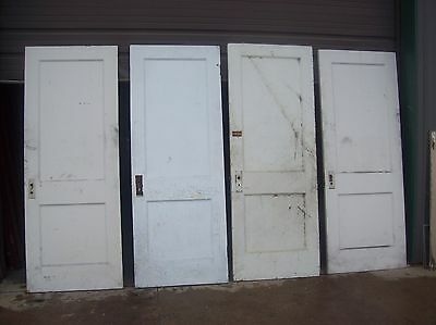 4 available painted 2 panel flat doors    (D q) 4