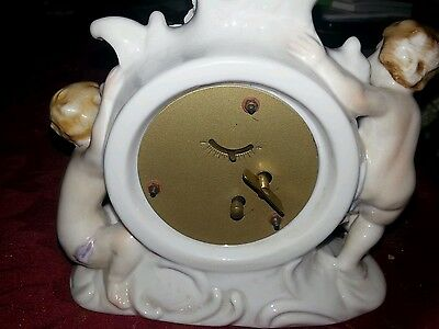 Antique  mantel clock with cherubs 2