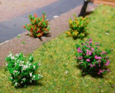 50 dunkelgrüne Büsche, rot, gelb, weiß, und violett blühend, 28 mm hoch 4