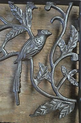 A pair of antique Victorian exotic bird brackets cast iron shelf bracket AL23 2