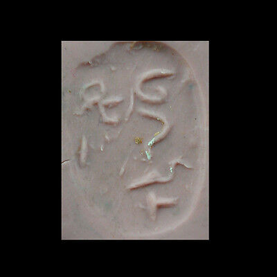 Clay stamp, the underside with an incised inscription x9636 5