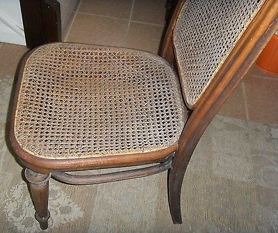 Antique wicker/rattan chair with wooden legs 4
