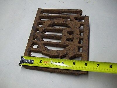 Broken part of antique furnace or stove vent or grate ? with design 2