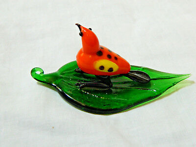 Hand Blown Glass Figure of an Orange Bird On A Glass Elm Leaf 3