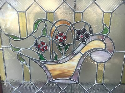 1 of a matched pair of floral stained glass windows 2