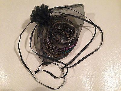 Set of 7 multi coloured elastic bracelets in a gift bag 3