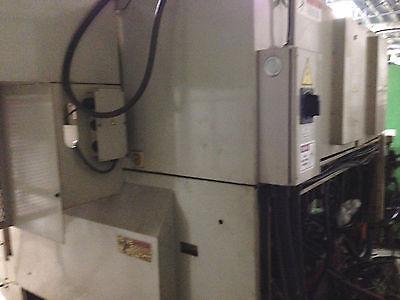Okuma & Howa 2SP-15HG Dual Spindle CNC Lathe Fanuc Twin Gantry Loading System
