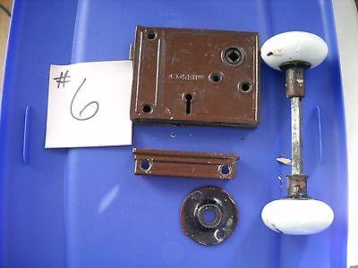 Pre 1876 cast iron horizontal rim lock set with white porcelain door knobs 4