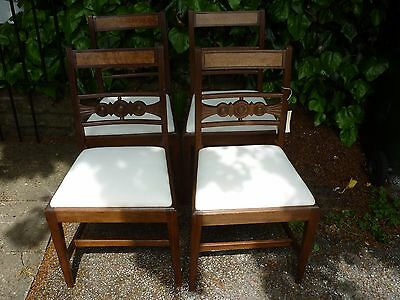 A set of four late victorian dining chairs. upholstered in calico. 7