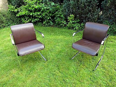 A pair of 'Peter Protzman' for 'Herman Miller', leather & tweed tubular chairs.