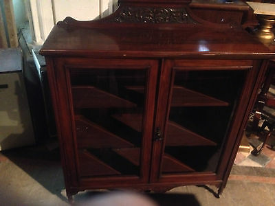 exceptional victorian carved mahogany book case with glass doors 2