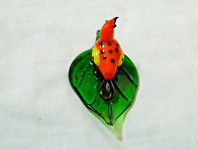 Hand Blown Glass Figure of an Orange Bird On A Glass Elm Leaf 4