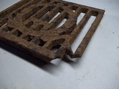 Broken part of antique furnace or stove vent or grate ? with design 4