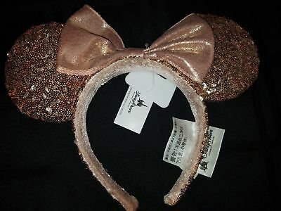 Brand new Disney Parks Rose Gold Sequin Minnie Mouse Ears