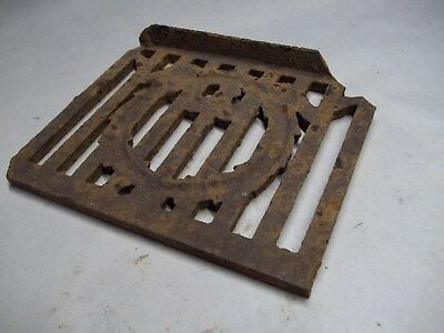 Broken part of antique furnace or stove vent or grate ? with design 11