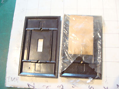 vintage INDUSTRIAL group of 2 LEVITON switch covers, one in plastic still 2