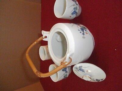 Vintage Porcelain Tea Pot Plus 3Cup Wicker Rattan Handle Japan Its Mark