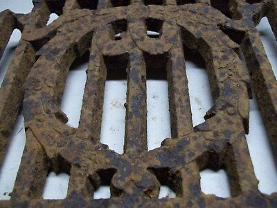 Broken part of antique furnace or stove vent or grate ? with design 8