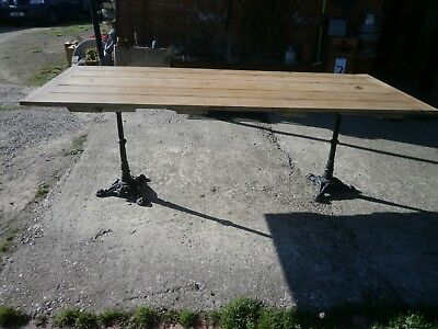 Antique pine table with twin pedestal cast iron legs 4