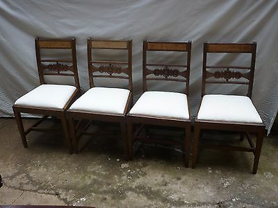 A set of four late victorian dining chairs. upholstered in calico. 4