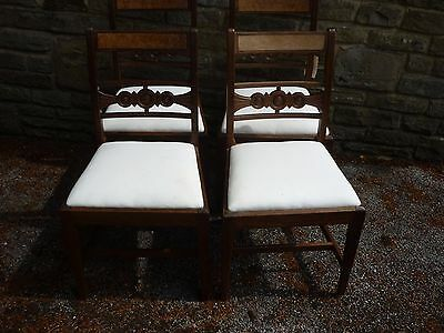 A set of four late victorian dining chairs. upholstered in calico. 5