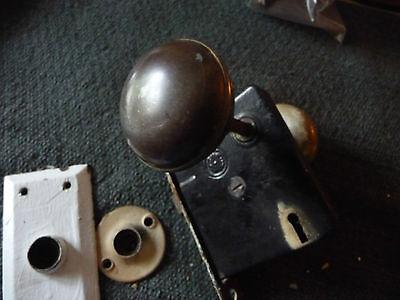 #56J antique vtg 1 metal door knob & 1 white porcelain w back plate & lock 7