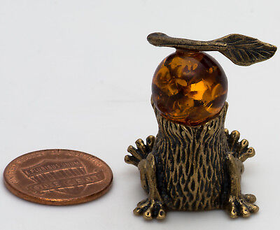 Brass Amber Figurine of Hedgehog in the fog with a snail IronWork