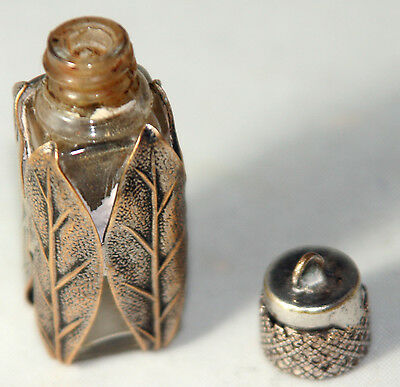 Original ANTIQUE c1900 PERFUME/SCENT BOTTLE surounded by COPPER LEAVES.LIFE LIKE
