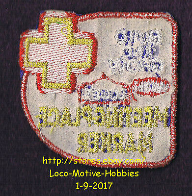 LMH PATCH Badge 2004 MEETING PLACE MARKER Emergency LOWES Build Grow Kids Clinic