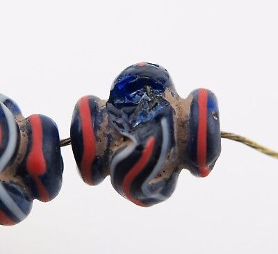 Fifteen blue red & white striped glass collared vase trade beads. 10