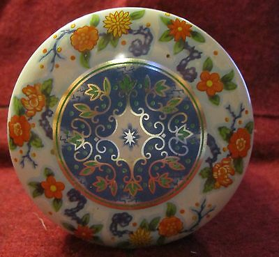 round chinese patterned tin designed by daher long island ny made in