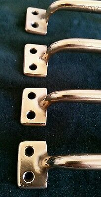 4 matching antique heavy cast brass handles or pulls restored 4