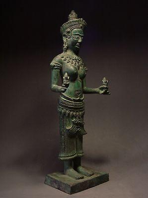 KHMER BRONZE FEMALE DEITY FIGURE, ANGKOR WAT 'BAYON' STYLE. CAMBODIA 18th C.