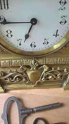 Beautiful ornate brass 8 day clock with 2 keys working nicely decorated solid 2