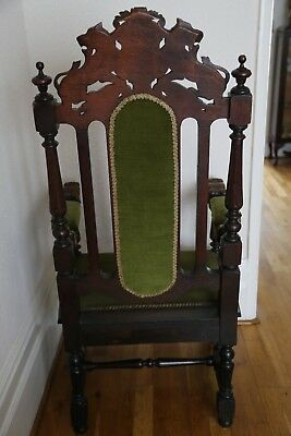 Pair of Antique oak throne armchairs with carved lions and intricate detail 8