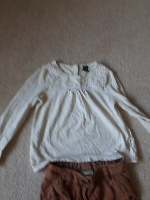 Girl's Age 5,  brown 3/4  length trousers by Next and a cream coloured top... 3