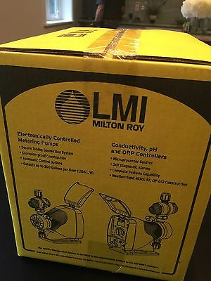 Brand New in Sealed box- LMI Milton Roy Dosing Pump- Model # AD911-910SI 4