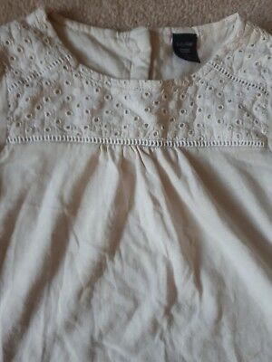 Girl's Age 5,  brown 3/4  length trousers by Next and a cream coloured top... 4
