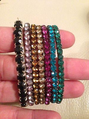 Set of 7 multi coloured elastic bracelets in a gift bag 2