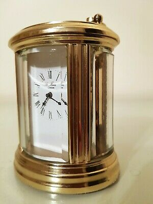 French Gilt Brass Oval Carriage Clock. 10