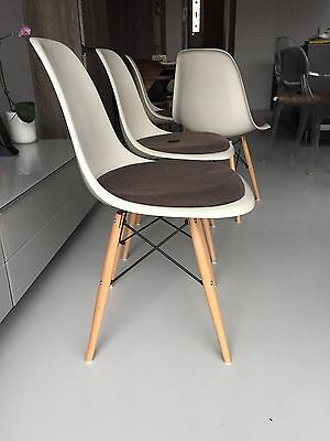 Vitra Original Charles Eames fibreglass upholstered chairs with dowel bases 3
