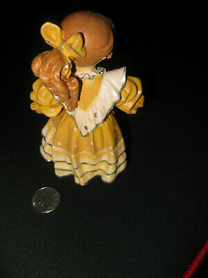 Unidentified 1995 wooden hand-carved doll 5
