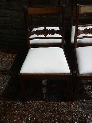 A set of four late victorian dining chairs. upholstered in calico. 6